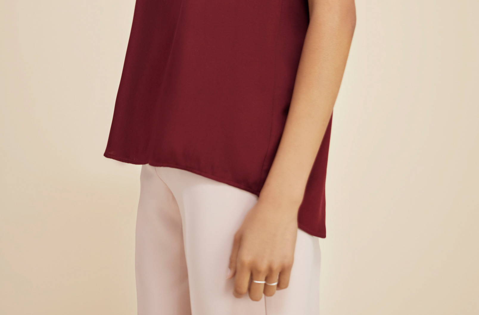 Detail shot of high-low hem of Cuyana Silk Tee