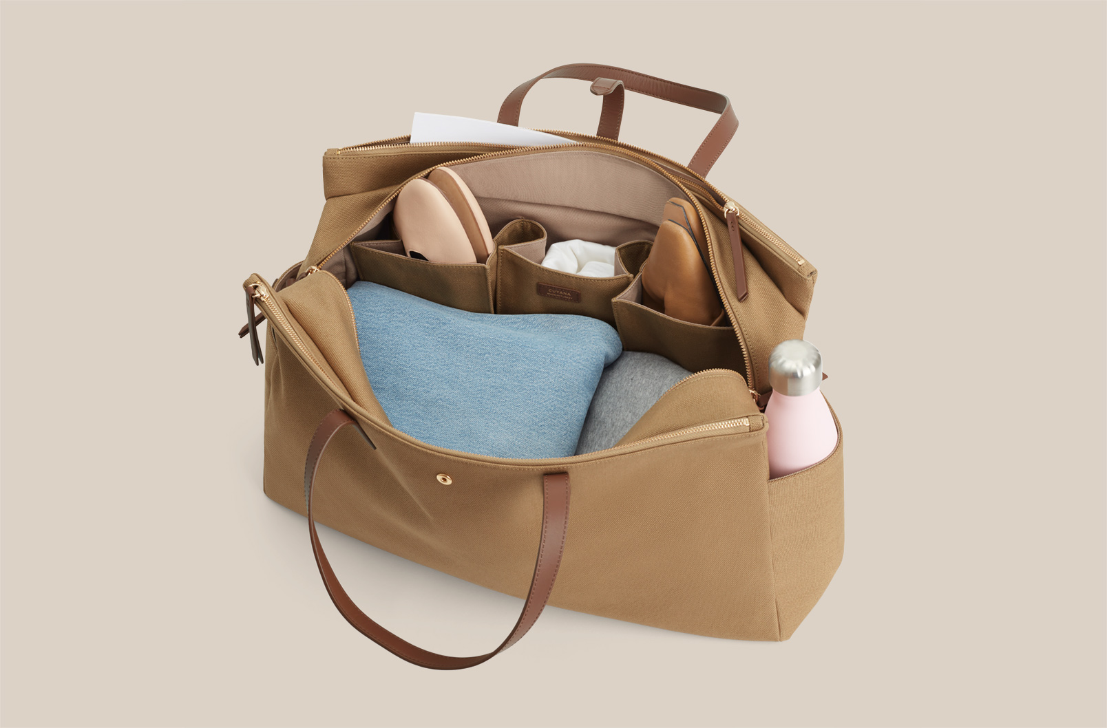 Interior shot of Triple Zipper Weekender with shoe compartments and sweaters