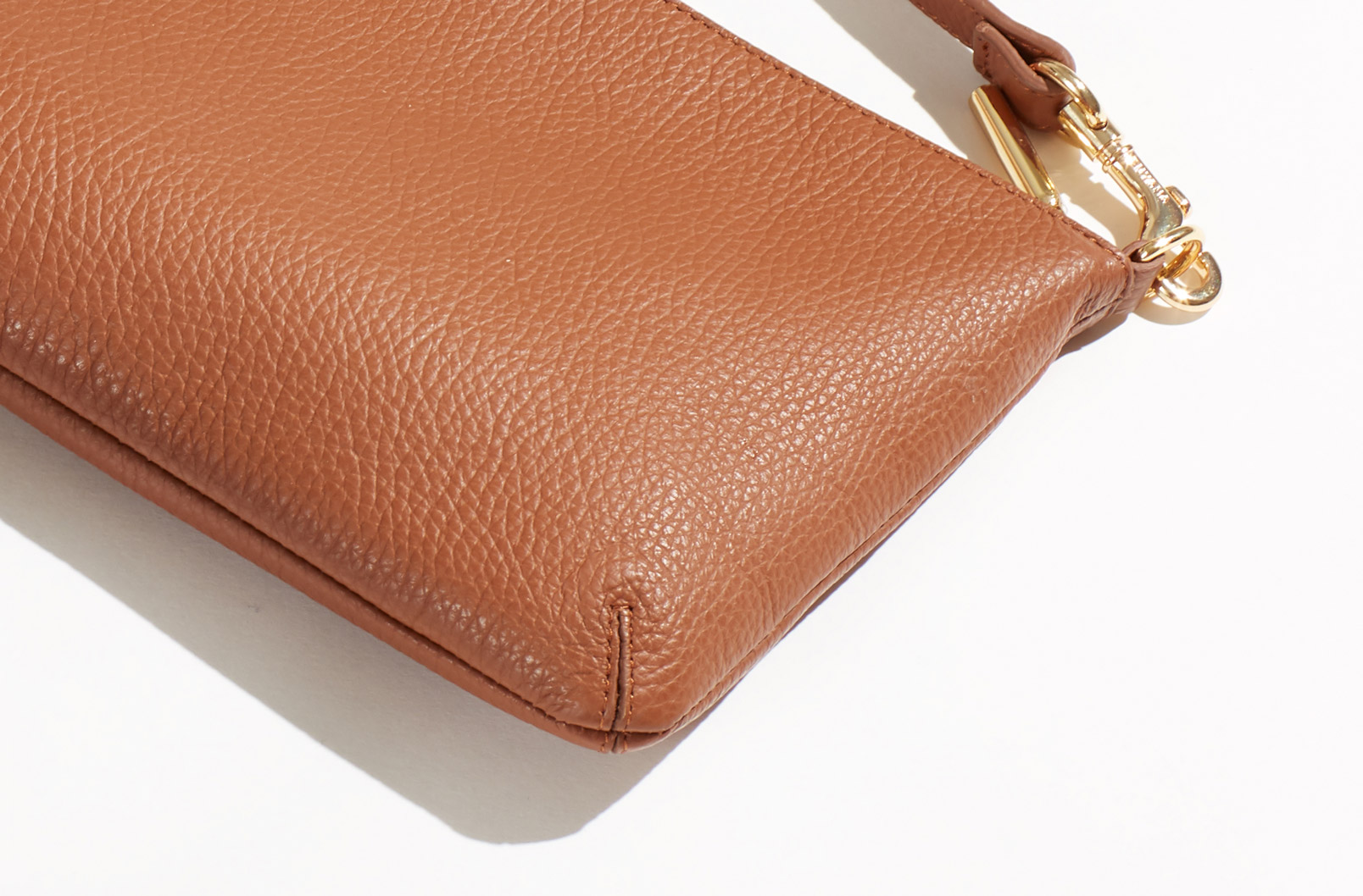 Detail shot showing seam details of Curved Crossbody pouch