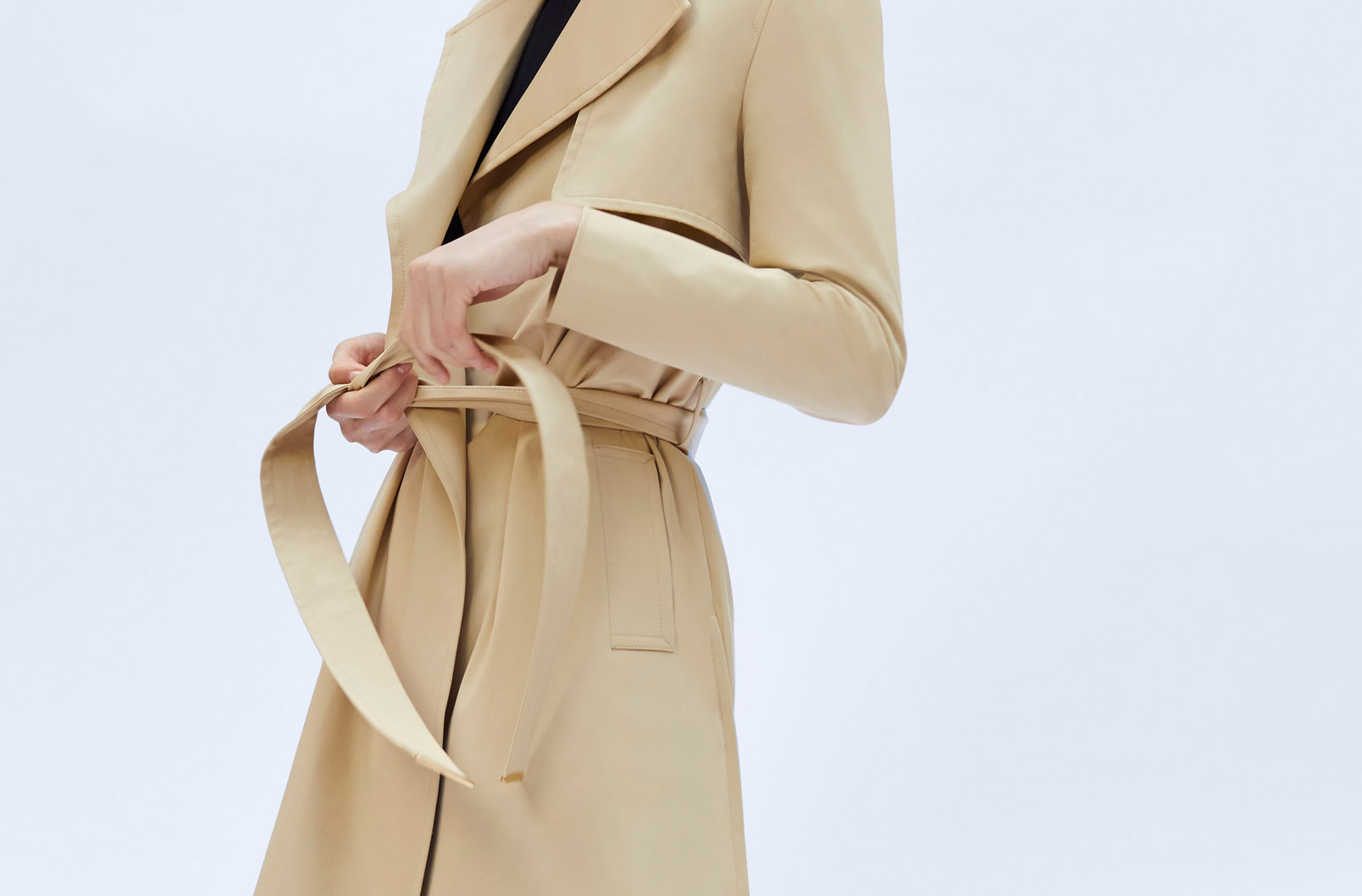 Model wearing Classic Trench belted shut